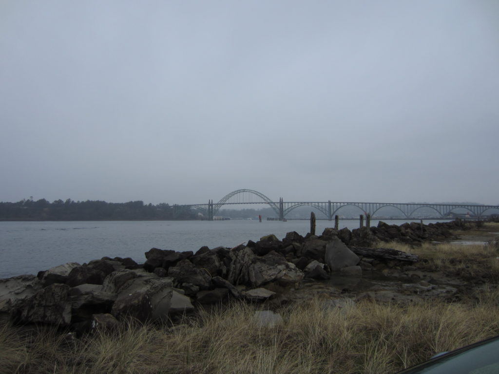 Yaquina Bay Bridge with several Oregon dive sites in the foreground